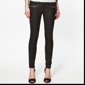 Zara black coated skinny jeans with gold zippers